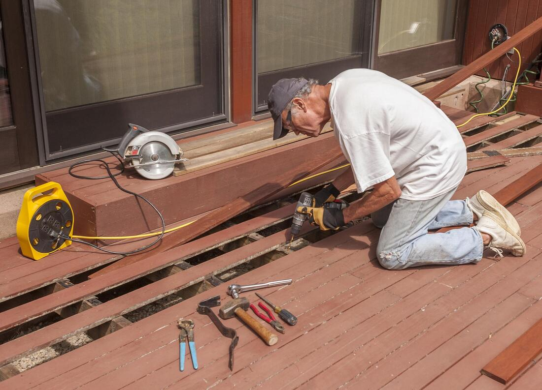 man doing deck repair restoration